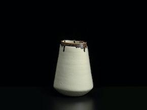 White vase with bronze rim
